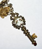 SNOOKS Key Necklace with Rust Orange Rhinestone